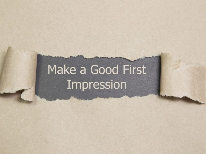 Make a Good First Impression message written under torn paper.